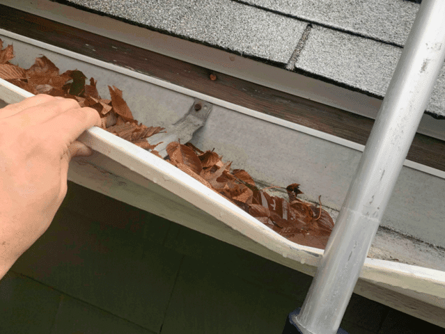 Warping gutter after being impacted by falling debris.