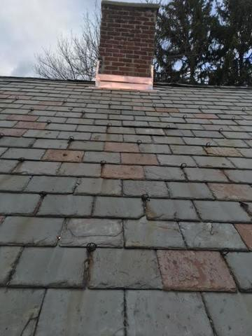 A view from down the roof shows how beautiful the copper can look alongside a slate roof.