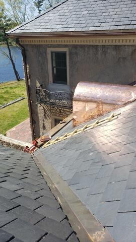 The final product of the copper dormer roof installation.