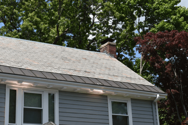 Newly installed copper panels preventing ice dams from forming and leaving this house with a slate roof looking beautiful!