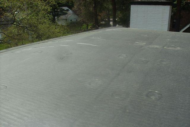 The finished flat roof easily hides all of the work that goes into installing it, but it is important to realize all of the work that goes into installing what you can't see.