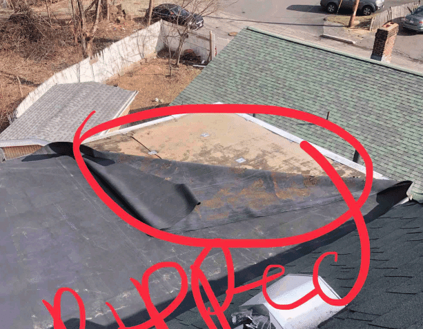 Ripped rubber roof before repair. This is extremely dangerous for a home as it allows water and snow to enter their home through the unsealed seams.
