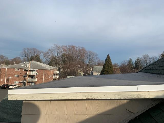 The rubber roof after repair. Brand new installation.