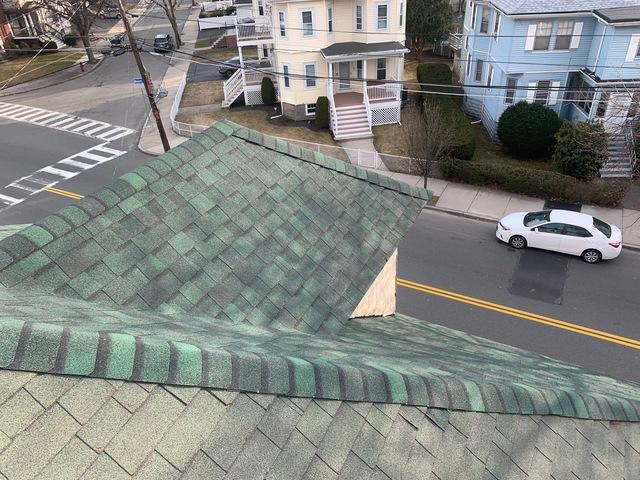 Shingle roof after repair. Brand new installation of asphalt shingles to protect the home from weather.