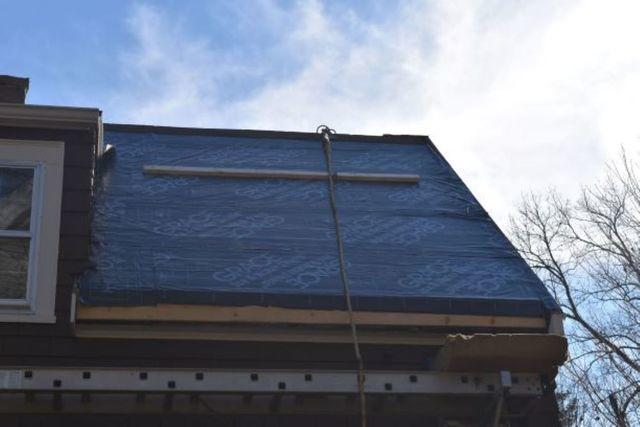 Placing Ice and Water Shield onto the back roof to prevent leaks and ice dams.