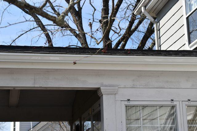 Installed aluminum gutters after removing rotting wooden gutters.
