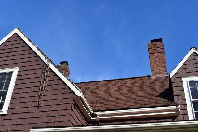 Rotting wood gutters were replaced with aluminum gutters,
