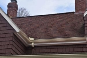 Aluminum gutter installation by a Needham roofing company.