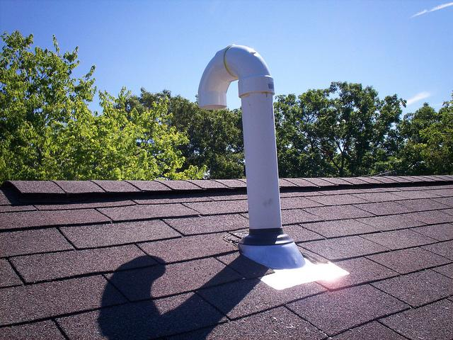 Asphalt shingle roof replacement, with a ridge vent installation.