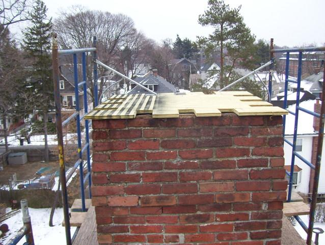 The first step of sealing off this chimney is the layer of plywood which the copper chimney cap will be build around.