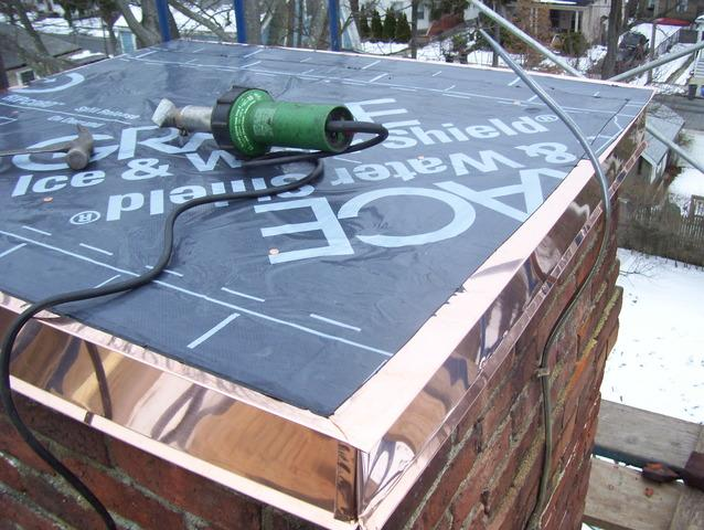 Once the copper has been installed around the perimeter of the chimney, the ice & water shield is applied to make sure the new chimney cap is water tight before the top is installed.