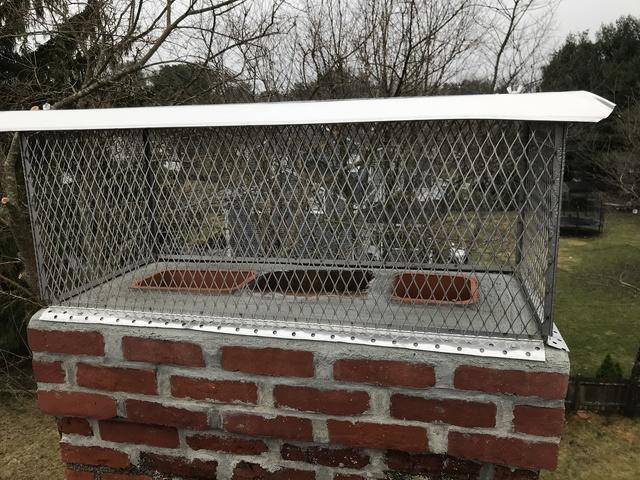 Re-pointed chimney with a brand new crown and stainless steel chimney cap