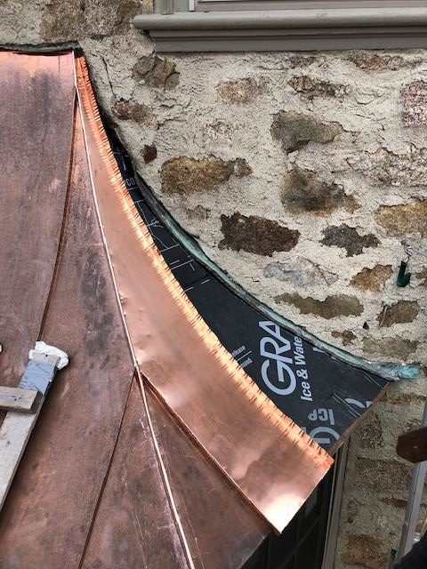 Installing the brand new, hand crafted copper dormer roof.
