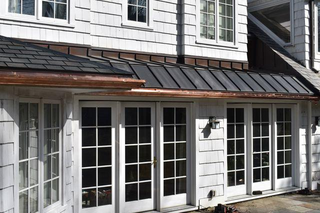 Installed copper gutters in the rear of the home. We removed wooden gutters before installation.