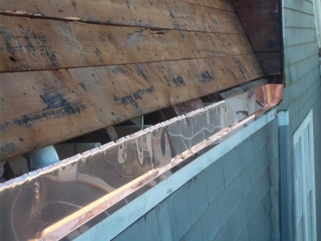 The old gutter has been removed, and out crew has begun the preparation to install the new copper gutter.