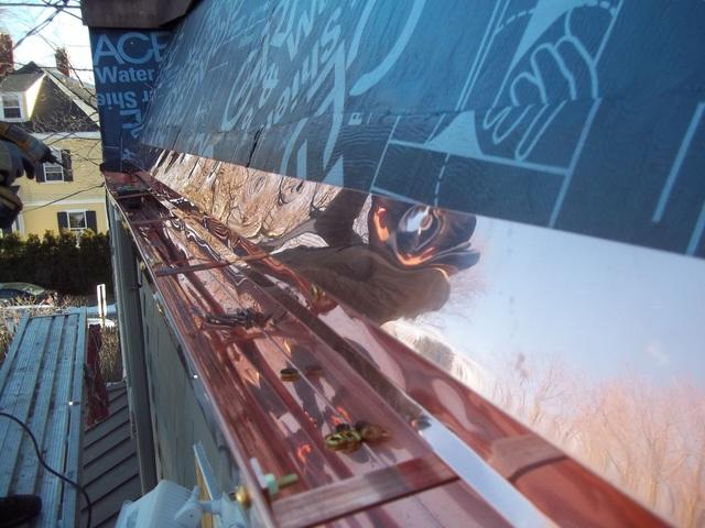 The installation of the copper gutter has begun, with our crew making sure that the areas where the gutter attaches to the roof will be water tight.