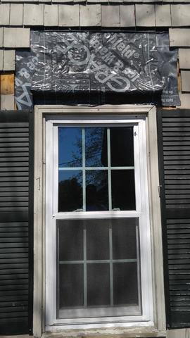 The first step after removing the overhang and siding is installing ice & water shield. This will keep the watter running down the new copper from penetrating the exterior of the home.