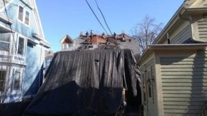 Asphalt roof being torn off for a roof replacement.