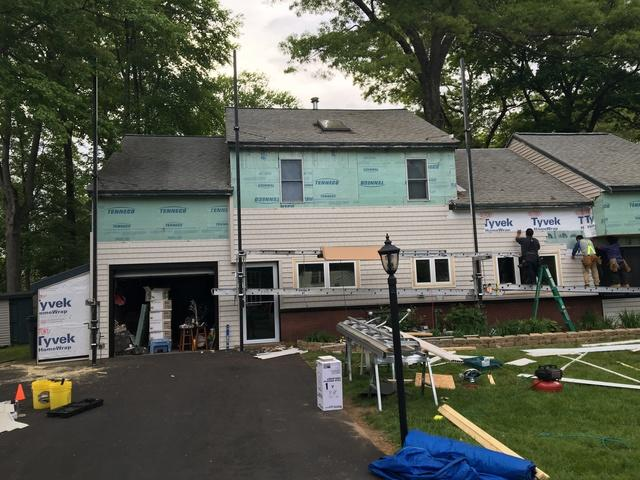 Here our crew begins installing the new siding, taking care to align everything up properly.