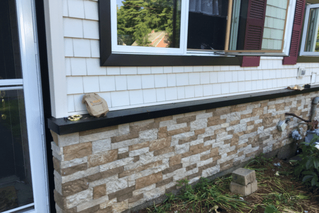 Closer look at the siding which has been installed right around the window.