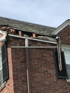 Home affected by snowstorm damage.