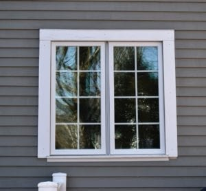 Needham window replacement by roofing company.