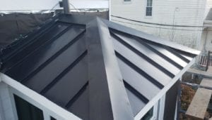 Standing-seam metal roof replacement.
