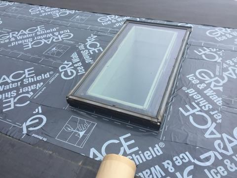 The area directly around the skylight has been fitted with ice & water shield for extra protection, and the rubber membrane can be seen as well.