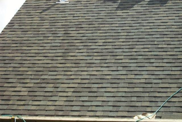 With the shingle roof installed, a close up shows the new shingles on the roof. With the job completed, this customer will not have to worry about leaks again.
