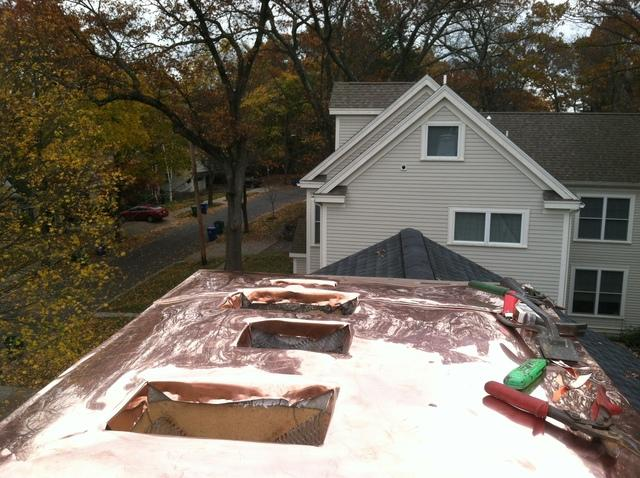 The copper is fabricated to fit perfectly into the openings in the chimney.