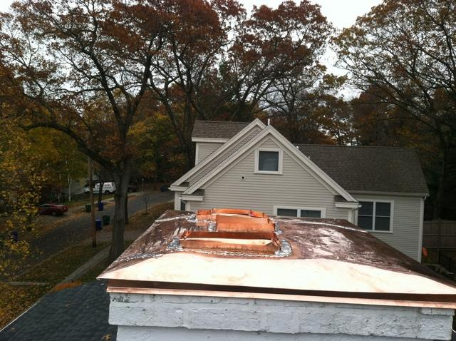 Our crew solders in the copper flues, making a seamless seal between the flues and the rest of the copper chimney cap.