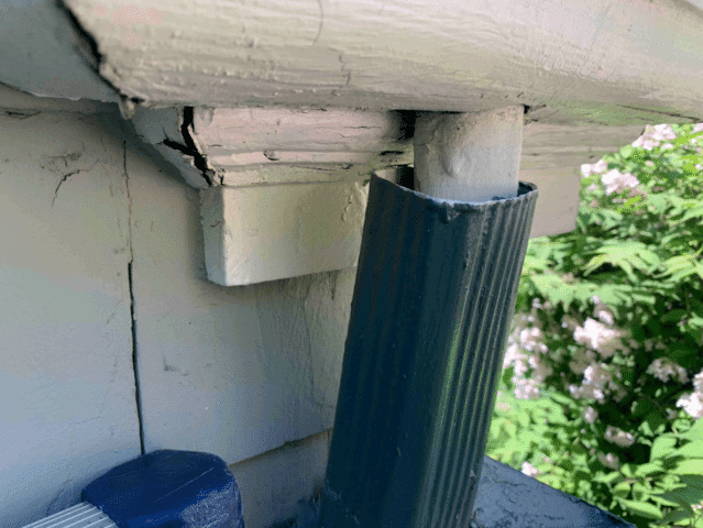 Rotting wooden gutters causing leaks.