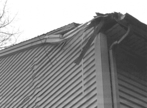 Damaged roof caused by weather. Fixed by roofing.