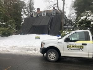 Asphalt Shingle Roof Replacement during winter roof work.
