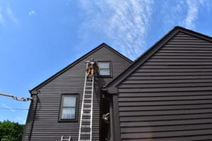 Roofing company installing replacement windows in Newton, MA