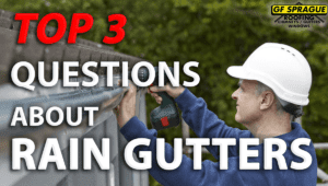 """Top 3 Questions about Rain Gutters"" over a roofing contractor installing rain gutters into a roof."